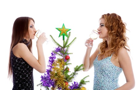 Two girls decorating fir and drinking champagne photo