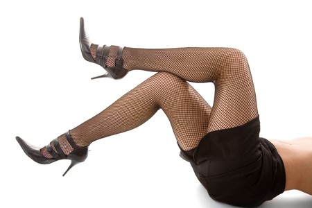 Legs in stockings on white isolated background photo