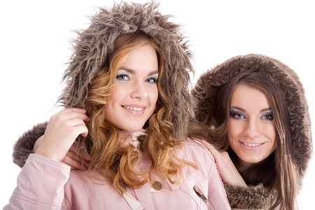 Two young girls posing in feather beds Stock Photo - 4123709