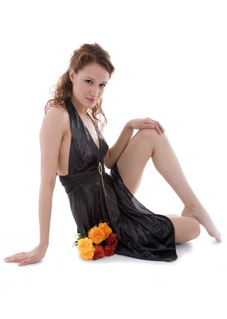 clavicle: Young attractive girl posing with colorful carnations