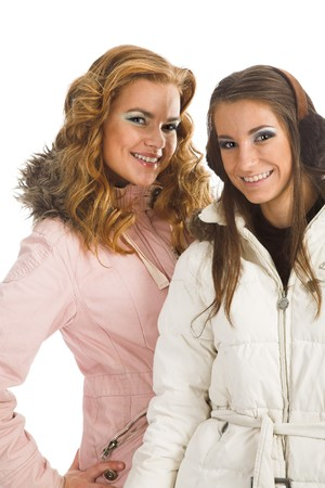 Two young girls posing in feather beds Stock Photo - 4123657