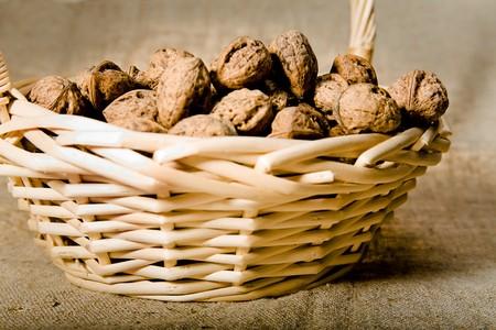 close up photo of walnut in basket photo