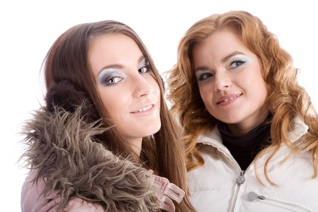 Two girls in feather beds are dreaming photo