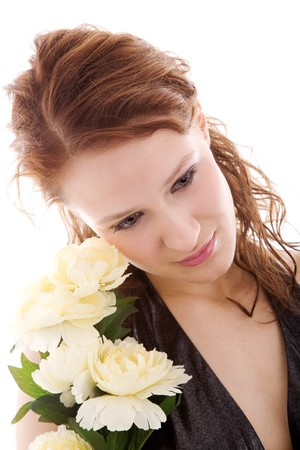 decolette: Young beautiful coquette posing archly with roses
