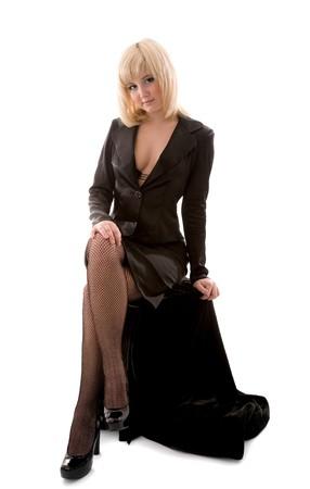 cross leg: Beautiful girl sitting on box and posing Stock Photo