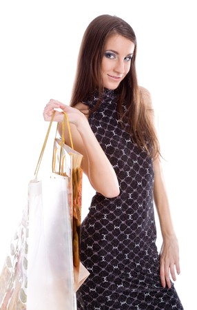 Girl holding paper bag and looking archly photo
