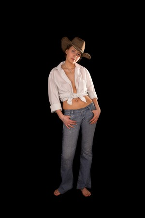 barefoot cowboy: Girl in hat on black isolated background Stock Photo