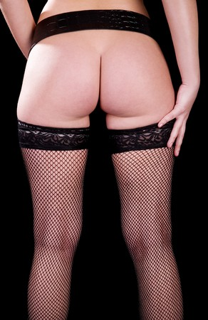 Girl in belt and stockings showing buttocks Stock Photo - 4265102