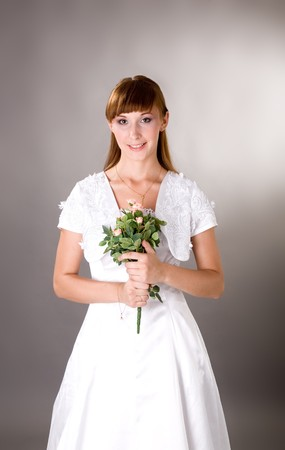 decolette: Young bride holding flowers and smiling innocent Stock Photo