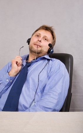 commentator: tired commentator in head set have a short rest Stock Photo