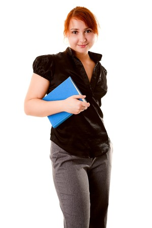 Girl holding a book and smiling confidently photo