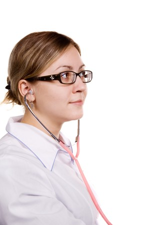 Doctor with stethoscope looking somewhere with interest Stock Photo - 4347731