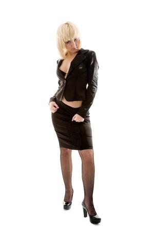 tight dress: Beautiful girl sitting on box and posing Stock Photo