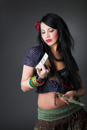 avidity: young beauty gipsy girl on the grey backgroung