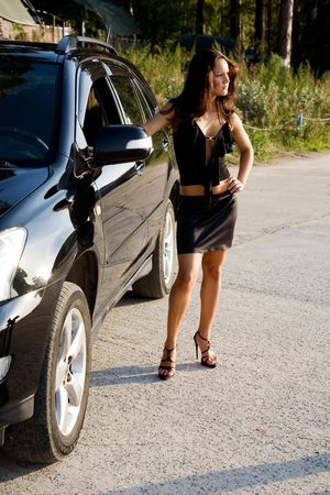 young beauty girl with car on road photo