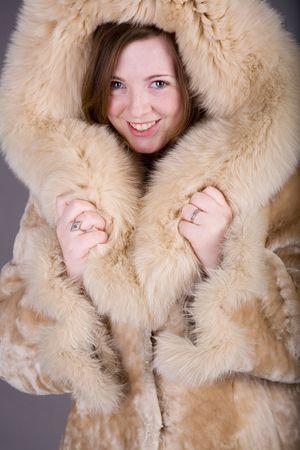 Gorgeous woman posing in nice fur coat photo