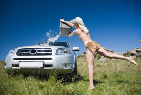 young girl washing car photo