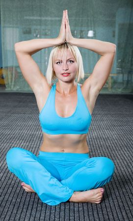 Fitness. Young caucasian woman in the gym photo
