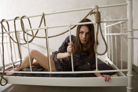 young woman with rope thinking about suicide photo