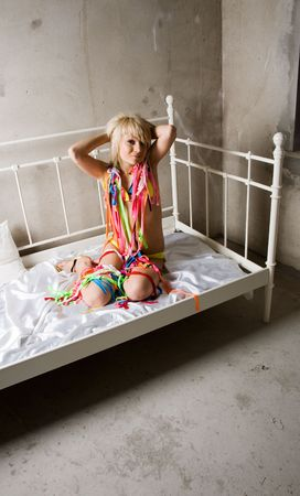 young beauty girl in the bed with colored band photo