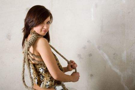 noose: young beauty girl with rope against wall Stock Photo