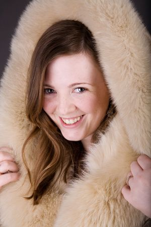 Gorgeous woman posing in nice fur coat photo
