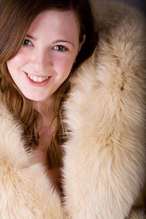 sexy fur: Gorgeous woman posing in nice fur coat Stock Photo