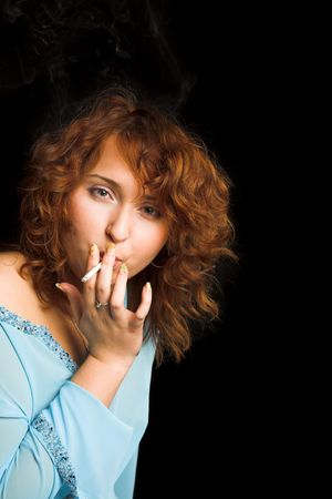 young beauty girl with cigarette on black photo