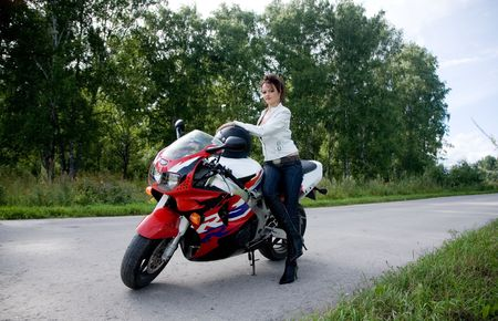 woman motorcycle: young beauty girl with motorbike on the road