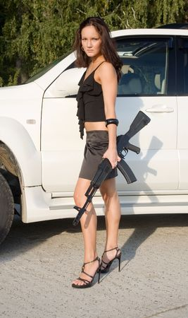 bangles hand: young beauty girl with gun and car
