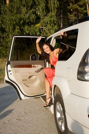young beauty girl in the white car photo