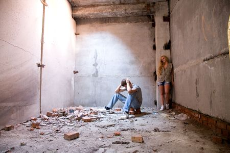 earthquake crack: young beauty lovers in the rusty building