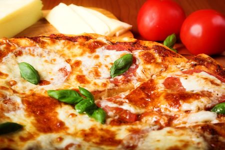fresh pizza with red tomato and cheese