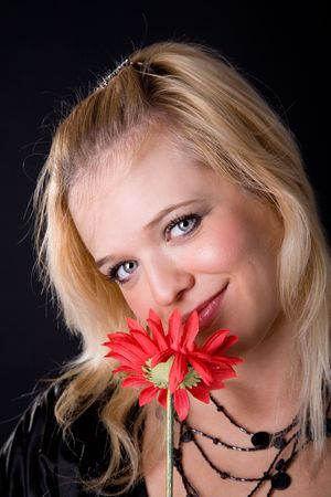 young beauty girl with red gerbera photo