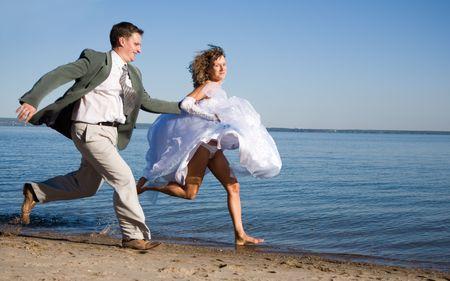 happy couple on the beach Stock Photo - 5759350