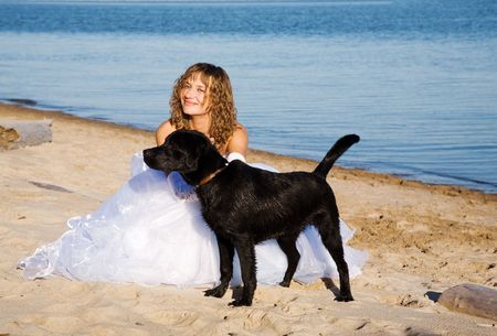 young happy bride with black dog photo
