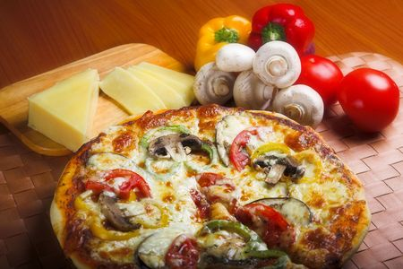cheese pizza: pizza with red tomato, mushrooms and cheese Stock Photo