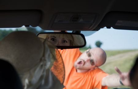 woman looking through windshield on the man photo