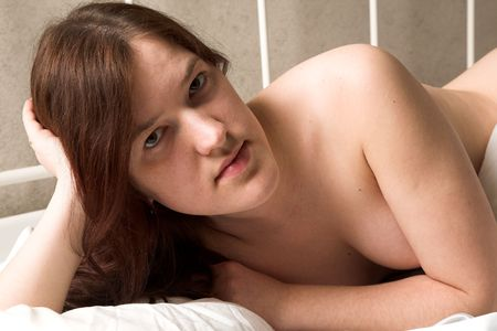penury: young beauty girl lying on the bed