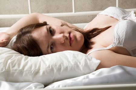 indigence: young beauty girl lying on the bed