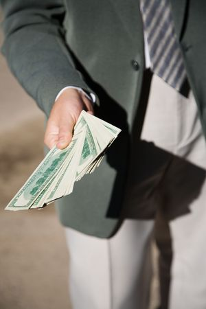 businessman hand with lot of money photo