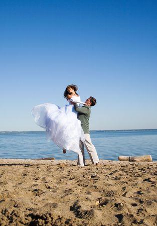 happy couple on the beach Stok Fotoğraf