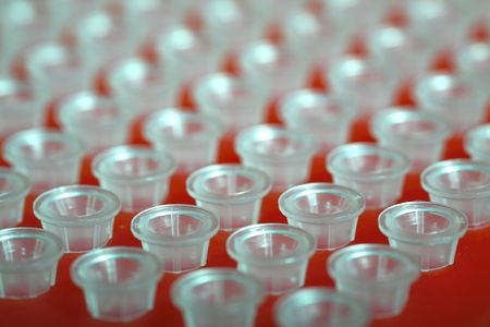 small plastic tubes in the red rack photo