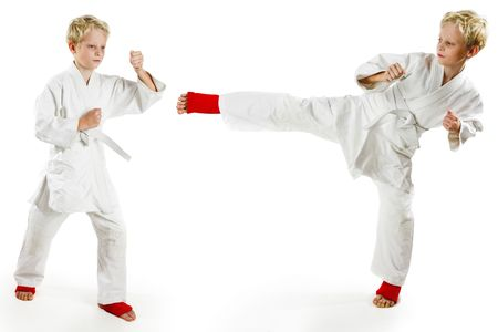 art activity: Karate boy exercising on white background
