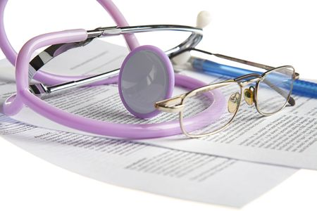 stethoscope, glasses and paper on white photo