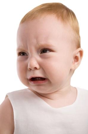 upset baby isolated on the white background