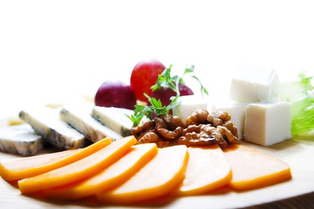 cheese and berry on the kitchen board photo