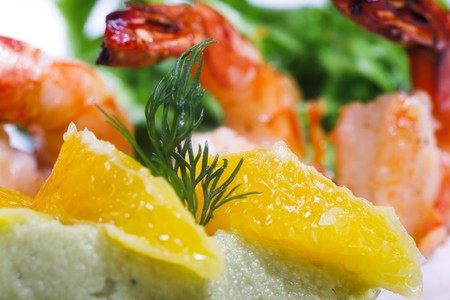 shrimps with citrus and greens isolated on white photo