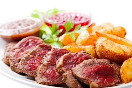 Fresh fried meat isolated on white background photo