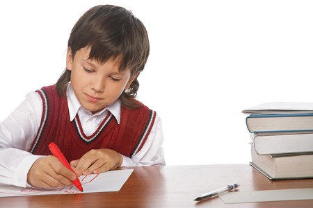 writing boy isolated on the white background photo